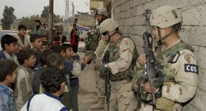 041211-A-3978J-026 U.S. Army 1st Lt. Jason Stanley (left), Staff Sgt. Chris McCarthy (center) and Capt. Phon Sundra talk with Iraqi children during a patrol in Mosul, Iraq, on Dec. 11, 2004.  The soldiers are assigned to Charlie Company, 1st Battalion, 24th Infantry Regiment, 1st Brigade, 25th Infantry Division.  DoD photo by Sgt. Jeremiah Johnson, U.S. Army.  (Released)